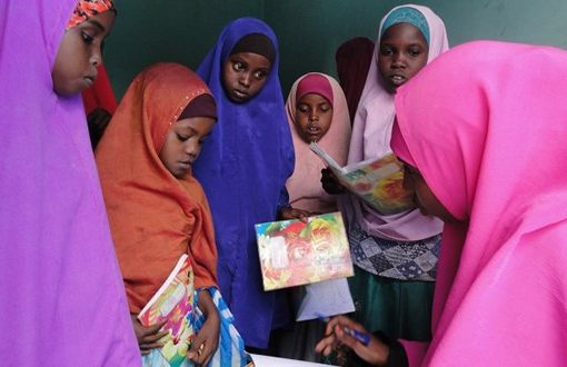 IDP mums studying alongside children at free camp school in Adado, central Somalia