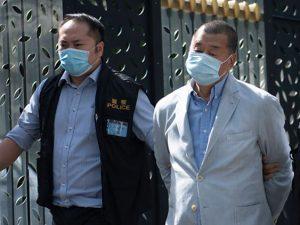 hong-kong-media-tycoon-arrested,-newspaper-raided
