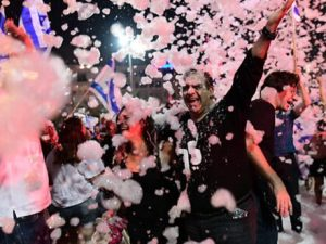 thousands-in-tel-aviv-celebrate-netanyahu-ouster-with-foam,-confetti-and-flags